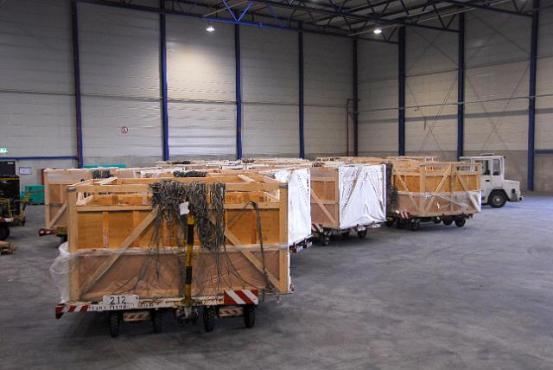 Transport boxes in a hall